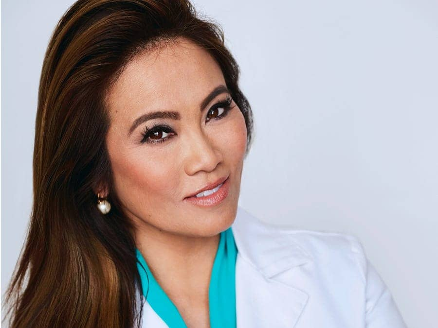 Dr. Pimple Popper (aka: Dr. Sandra Lee) posesfor her reality TV show on TMZ