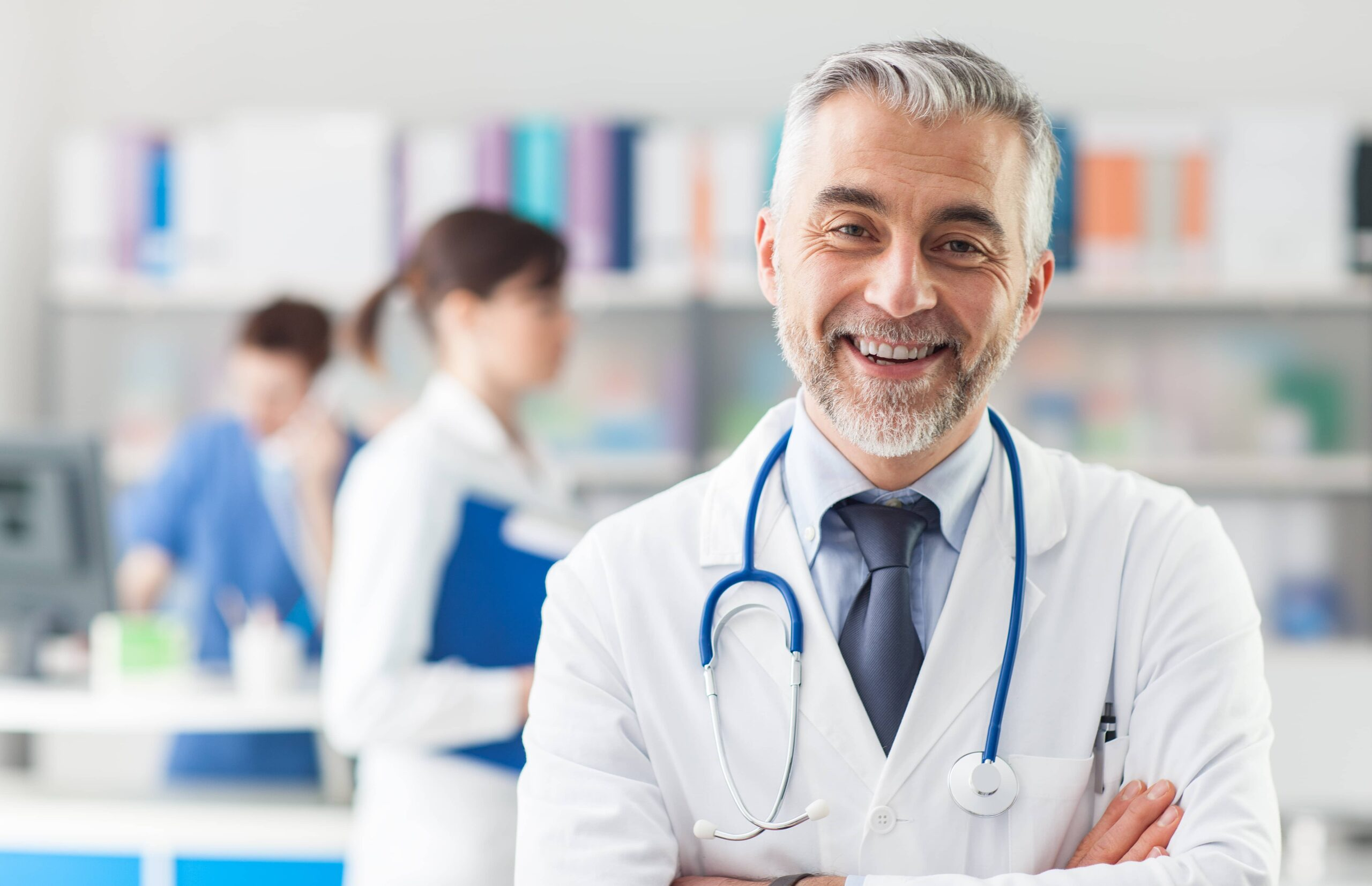 older male physician smiling at the viewer